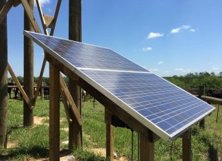 Photovoltaic panel providing solar power to a remote well used for watering livestock. ( Jennifer Bearden, University of Florida Extension )
